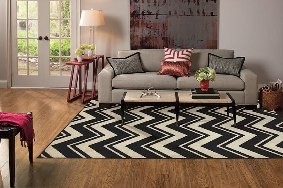 Area rugs bring the room together, add comfort, character  and style
