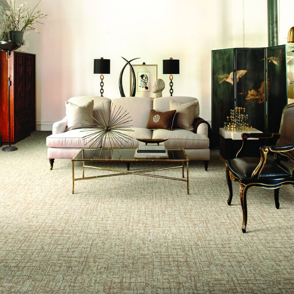 How to Lay an Area Rug Over Carpet Flooring